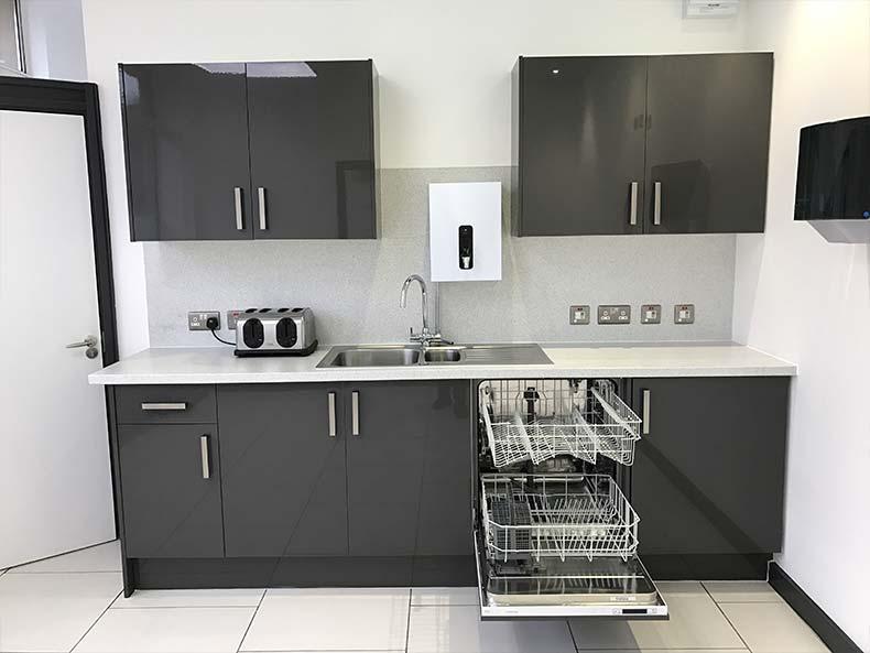 Modern office kitchen with dishwasher
