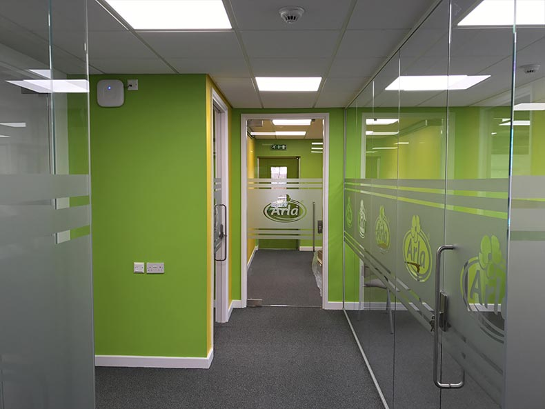 Arla office corridor with glass partitioning