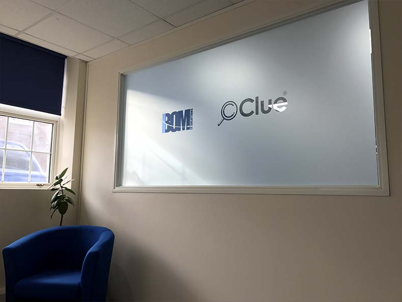 BOM IT office window with logos