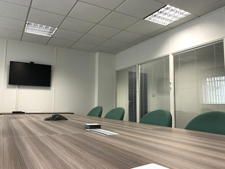 Ecobat office meeting room with screen