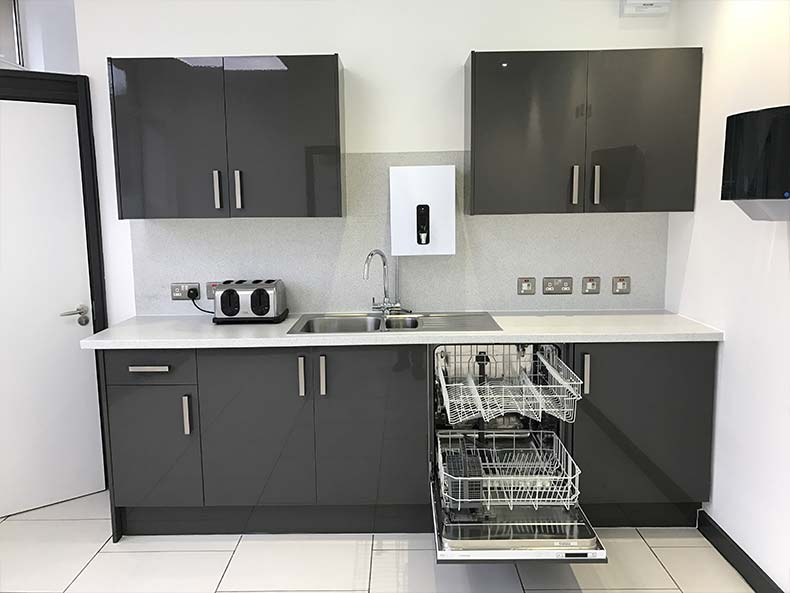 Modern office kitchen with dishwasher