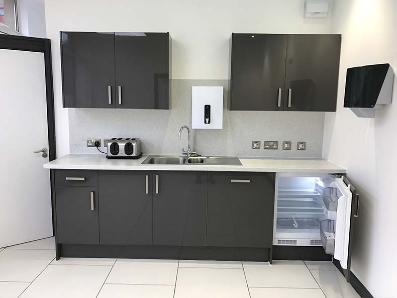Modern office kitchen with fridge